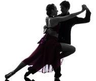 Dançarinos do salão de baile da mulher do homem dos pares que tangoing a silhueta Imagens de Stock