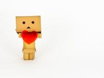 Danbo που κρατά μια καρδιά Στοκ Εικόνες