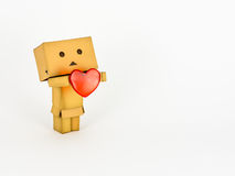 Danbo holding a heart. Cute Danbo character lovingly holds out a red heart Stock Photo