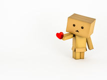 Danbo holding a heart. Cute Danbo character lovingly holds out a red heart Stock Photos