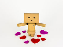 Danbo standing amongst hearts. Cute Danbo character posing adorably with outstretched arms surrounded by hearts Stock Photography