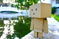 Danboard or Danbo Figure in the garden. Danboard, Danbo first appeared in chapter 28 of the manga, first issued in April 2006. Yotsuba Koiwai's friend Miura Royalty Free Stock Photography
