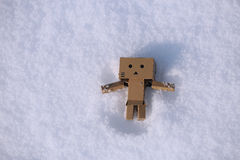 Danboard in the snow. Danboard character lying in the snow, winter time stock photography