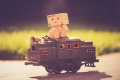 Danboard on Top of Toy Train Royalty Free Stock Photos