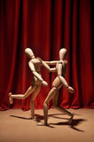 Dance. Wooden mannequin characters performing a dance on drama stage Royalty Free Stock Image