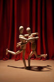Dance. Wooden mannequins performing a dance in drama Stock Image