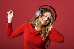 Dance. Young woman listening to music and moves to Royalty Free Stock Photo