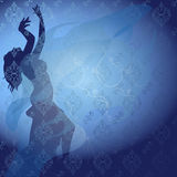 Dance. Silhouette of a girl dancing at the blue curtain Stock Photo