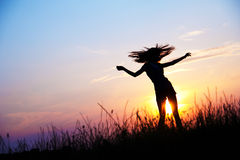 Dance. Woman dancing in the medow, sunrise Stock Image
