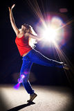 Dance. Young sexy dancing woman in rays of light Stock Photos