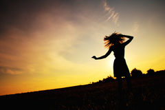 Dance. Happy woman dancing in the meadow, sunrise Royalty Free Stock Photos