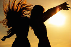 Dance. Happy girls dancing in the medow, sunrise Royalty Free Stock Photo