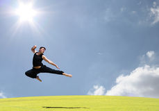 Dance. A boy jumping with excitemant in the air Royalty Free Stock Photo