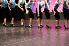 Dance. Group of girls dancing on the stage royalty free stock photography