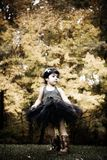 Dance. Toddler dancing in her black tutu and boots during fall Royalty Free Stock Image