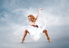 Dance of ballerina with dress of milk Royalty Free Stock Photos