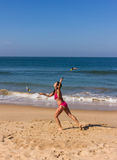 Dance at the beach of Goa. A beautiful girl in a red bikini is performing a poi-dance at the beach of Goa Royalty Free Stock Photo