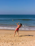 Dance at the beach of Goa. A beautiful girl in a red bikini is performing a poi-dance at the beach of Goa Stock Photos