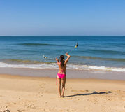 Dance at the beach of Goa. A beautiful girl in a red bikini is performing a poi-dance at the beach of Goa Stock Images