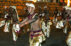 Dance of Beetle dancers perform along the streets of Kandy during the Esala Perahera in Sri Lanka. Stock Photography