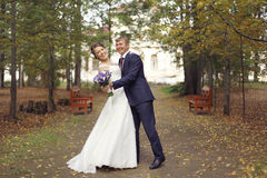 Dance bride and groom in autumn park Royalty Free Stock Images