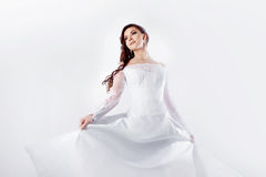 Dance bride in wedding dress, white background. Beautiful smiling woman in a wedding dress Royalty Free Stock Photos
