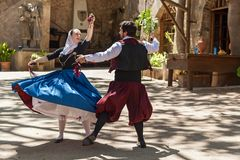 Dance with castanets. Spain Palma de Mallorca June 23, 2016: Dances with castanets of two graceful dancers in old costumes at the estate Camino de Caledor. San Royalty Free Stock Images