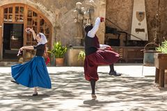 Dance with castanets. Spain Palma de Mallorca June 23, 2016: Dances with castanets of two graceful dancers in old costumes at the estate Camino de Caledor. San Royalty Free Stock Photography