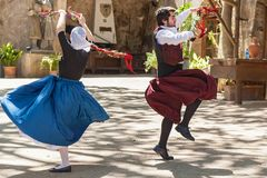 Dance with castanets. Spain Palma de Mallorca June 23, 2016: Dances with castanets of two graceful dancers in old costumes at the estate Camino de Caledor. San Royalty Free Stock Image