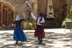 Dance with castanets. Spain Palma de Mallorca June 23, 2016: Dances with castanets of two graceful dancers in old costumes at the estate Camino de Caledor. San Royalty Free Stock Photo