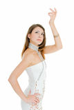 Dance of charming girl. Young adult beauty girl in dancing pose on white Royalty Free Stock Image