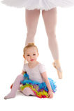Dance Child with Ballerina Legs. An infant dance child in a tutu with a ballerina's legs in platter tutu Royalty Free Stock Photo