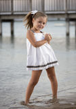 Dance child. A beautiful girl, posing on a beach at sunset Stock Images