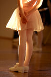 Dance class. A young dancer wearing tap shoes waits for the start of class royalty free stock photos