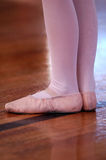 Dance class. A young dancer wearing ballet shoes taking part in a dance class royalty free stock photography