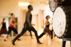 Dance class with African drums. Dance class with instructor and close up of African drums Royalty Free Stock Photo