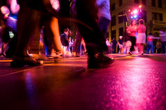 Dance Club. A low shot of the dance floor with people dancing under the colorful lights Royalty Free Stock Photography