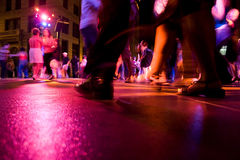 Dance Club. A low shot of the dance floor with people dancing under the colorful lights Royalty Free Stock Photo