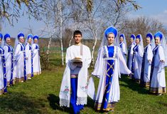 A dance collective with Russian bread and salt among the birches Royalty Free Stock Photo