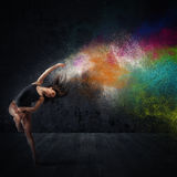 Dance with colored pigments Royalty Free Stock Photo