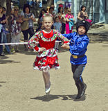 Dance couple. Children dancing in the Cossack costumes royalty free stock image