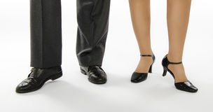 Two dancers feet in crocodile shoes Royalty Free Stock Photography