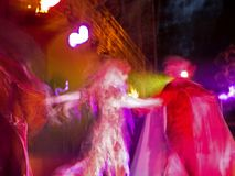 Dance of Fire. This is an abstract blur of a colorful live show at night Royalty Free Stock Photo