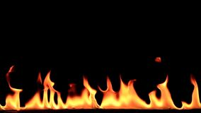 Dance of the flames. Flames in front of black background stock footage