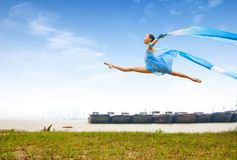 Dance girl. River, jumping dance girl, holding streamers Royalty Free Stock Image