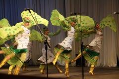 Dance in green costumes. Folk ensemble Kazachya Volnitsa in Ekaterinburg, Russia. September 2014. Beautiful ethnic dance and patriotic songs stock photo
