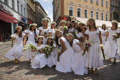 Dance group �Dzirnas� members in Old Riga Stock Image