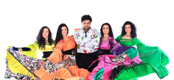 Dance group of gypsies, dancing and waving their magnificent dresses Royalty Free Stock Image
