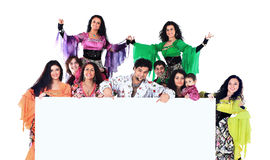 Dance group of Gypsies, are holding a huge banner and show up on your ad copy Royalty Free Stock Photography