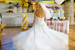 Dance of Happiness. Bride in a long white dress circling a happy dance Stock Photography